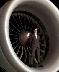 Aerospace-executive-on-location-corporate-portrait-standing-in-jet-engine