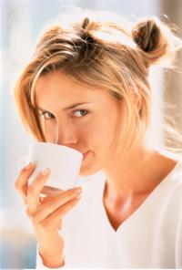 MTPA-Cute-girl-drinking-tea-near-window-sunlight